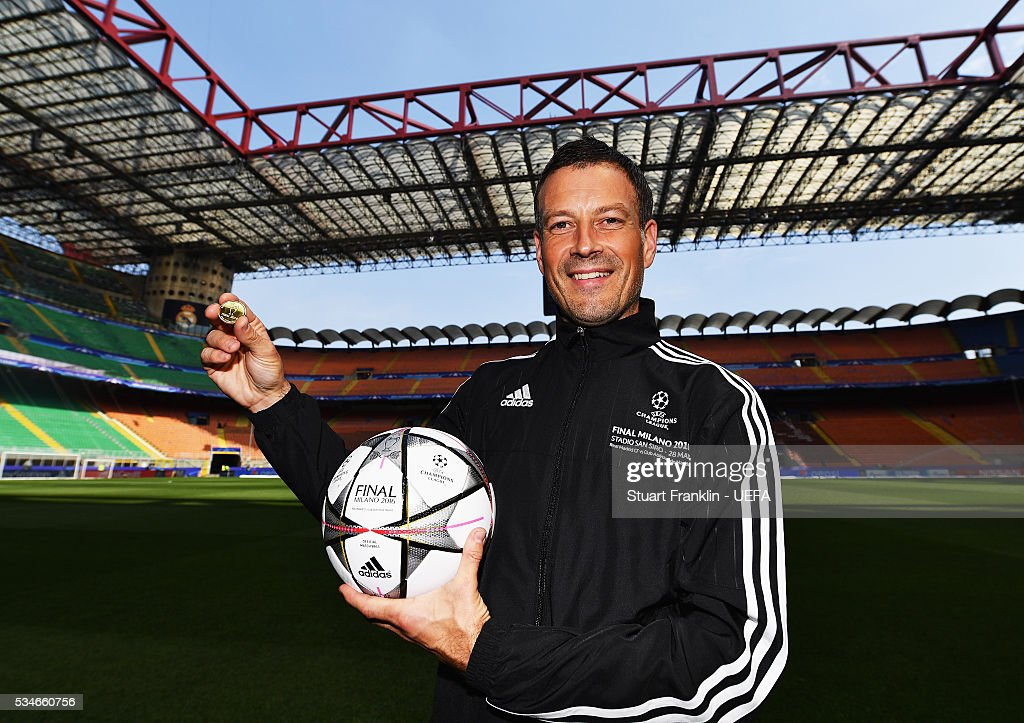 Referee <a gi-track='captionPersonalityLinkClicked' href=/galleries/search?phrase=Mark+Clattenburg&family=editorial&specificpeople=2108870 ng-click='$event.stopPropagation()'>Mark Clattenburg</a> holds the official match ball and coin prior to the UEFA Champions League Final between Athletico Madrid and Real Madrid at Stadio Giuseppe Meazza on May 27, 2016 in Milan, Italy.