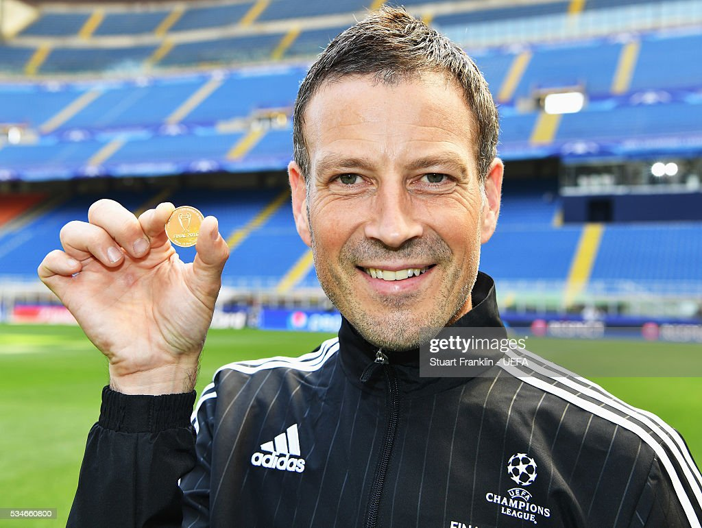Referee <a gi-track='captionPersonalityLinkClicked' href=/galleries/search?phrase=Mark+Clattenburg&family=editorial&specificpeople=2108870 ng-click='$event.stopPropagation()'>Mark Clattenburg</a> holds the official match coin prior to the UEFA Champions League Final between Athletico Madrid and Real Madrid at Stadio Giuseppe Meazza on May 27, 2016 in Milan, Italy.