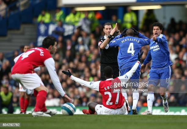 Referee Mark Clattenburg is shouted at by Chelsea's Claude Makelele and Michael Ballack