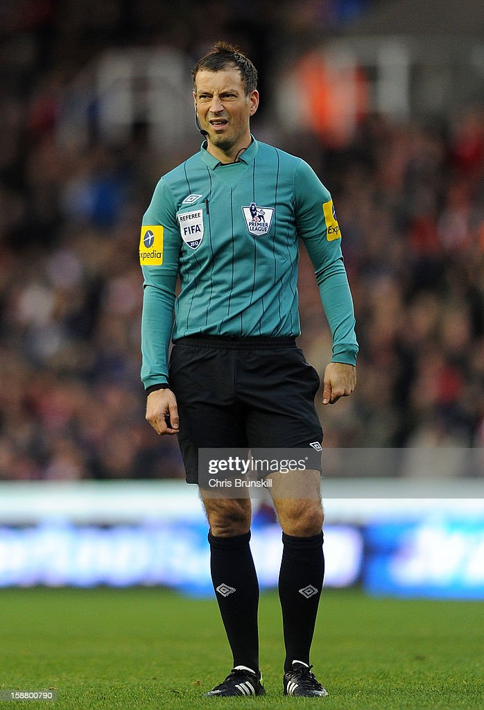 Referee Mark Clattenburg looks on during the Barclays Premier League match between Stoke City and Southampton at Britannia Stadium on December 29, 2012 in Stoke on Trent, England.