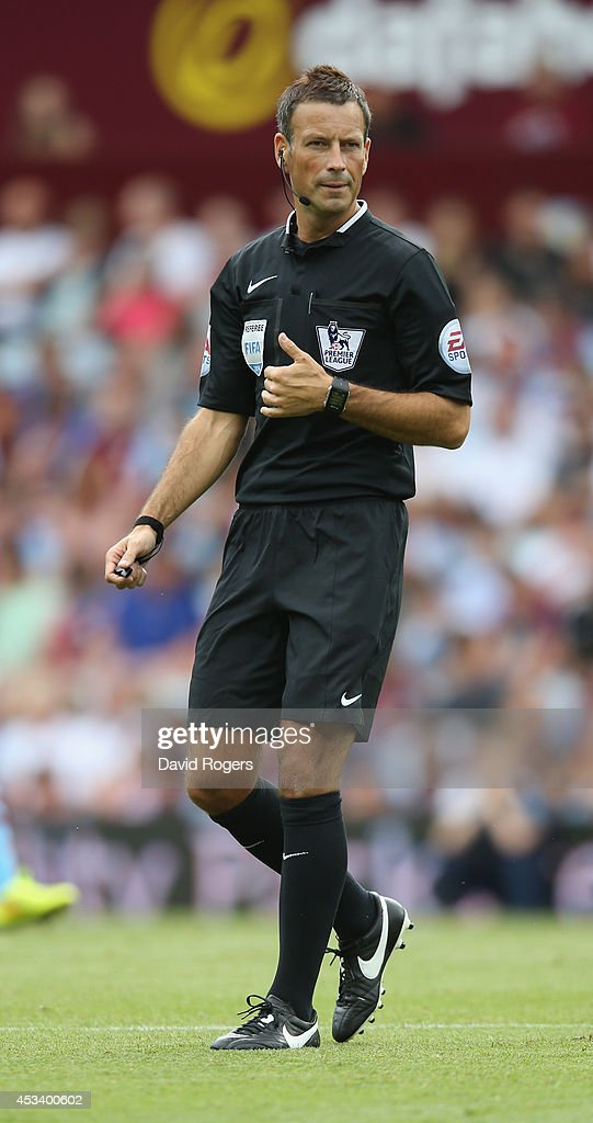 Referee Mark Clattenburg looks on during the pre season friendly match between Aston Villa and Parma at Villa Park on August 9, 2014 in Birmingham, England.