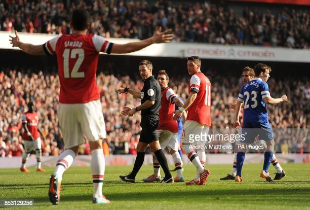Referee Mark Clattenburg orders Arsenal's Mikel Arteta to take his penalty again after the first was ruled out for encroaching by Olivier Giroud