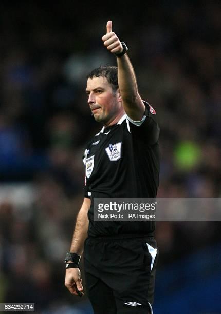 Referee Mark Clattenburg raises his thumb in the air