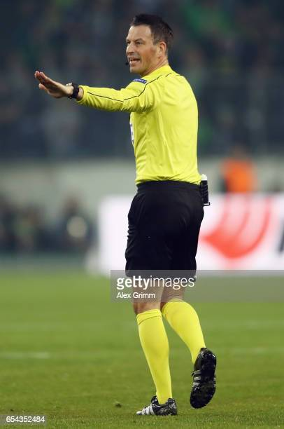 referee Mark Clattenburg reacts during the UEFA Europa League Round of 16 second leg match between Borussia Moenchengladbach and FC Schalke 04 at...