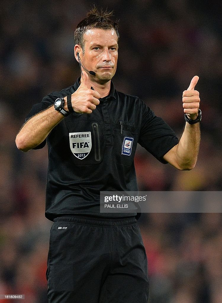 Referee Mark Clattenburg reacts reacts during the League Cup football match between Manchester United and Liverpool at Old Trafford in Manchester on September 25, 2013. Manchester United won 1-0.