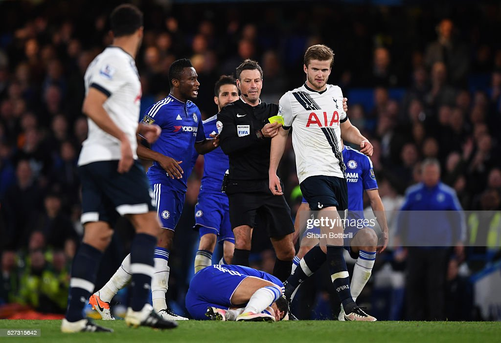 Referee <a gi-track='captionPersonalityLinkClicked' href=/galleries/search?phrase=Mark+Clattenburg&family=editorial&specificpeople=2108870 ng-click='$event.stopPropagation()'>Mark Clattenburg</a> shows a yellow card to <a gi-track='captionPersonalityLinkClicked' href=/galleries/search?phrase=Eric+Dier&family=editorial&specificpeople=9440610 ng-click='$event.stopPropagation()'>Eric Dier</a> of Tottenham Hotspur after bringing down <a gi-track='captionPersonalityLinkClicked' href=/galleries/search?phrase=Eden+Hazard&family=editorial&specificpeople=5539543 ng-click='$event.stopPropagation()'>Eden Hazard</a> of Chelsea during the Barclays Premier League match between Chelsea and Tottenham Hotspur at Stamford Bridge on May 02, 2016 in London, England.jd