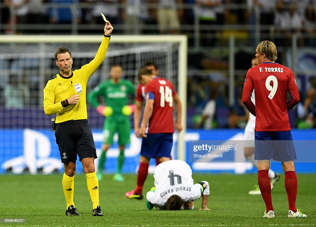 referee <a gi-track='captionPersonalityLinkClicked' href=/galleries/search?phrase=Mark+Clattenburg&family=editorial&specificpeople=2108870 ng-click='$event.stopPropagation()'>Mark Clattenburg</a> shows a yellow card to <a gi-track='captionPersonalityLinkClicked' href=/galleries/search?phrase=Fernando+Torres&family=editorial&specificpeople=194755 ng-click='$event.stopPropagation()'>Fernando Torres</a> of Atletico Madrid during the UEFA Champions League Final match between Real Madrid and Club Atletico de Madrid at Stadio Giuseppe Meazza on May 28, 2016 in Milan, Italy.