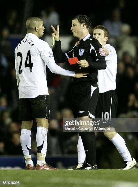 Referee Mark Clattenburg shows Fulham's Hameur Bouazza the red card for a second bookable offence