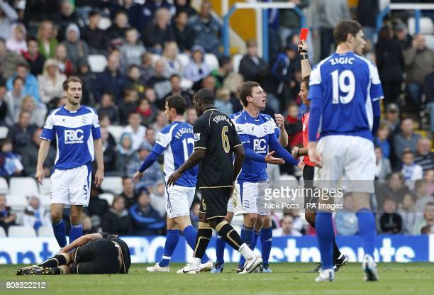 Referee Mark Clattenburg shows the red card to Birmingham City's Craig Gardner for his foul on Wigan Athletic's Franco Di Santo