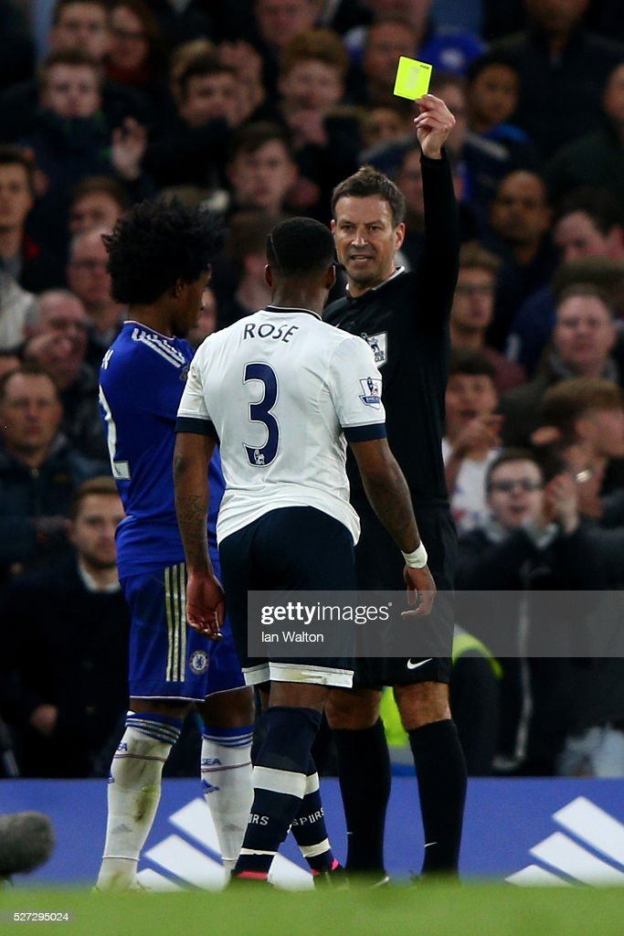 Referee Mark Clattenburg shows the yellow card to Willian of Chelsea and Danny Rose of Tottenham Hotspur during the Barclays Premier League match between Chelsea and Tottenham Hotspur at Stamford Bridge on May 02, 2016 in London, England.