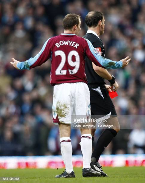 Referee Mark Clattenburg shows West Ham United's Lee Bowyer the red card late in the game