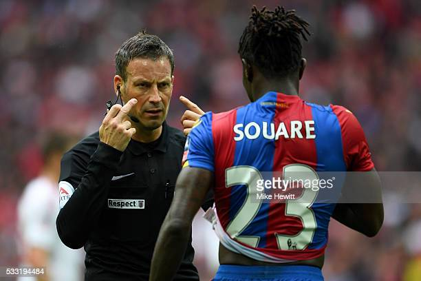 Referee Mark Clattenburg signals to Pape N'Diaye Souare of Crystal Palace during The Emirates FA Cup Final match between Manchester United and...