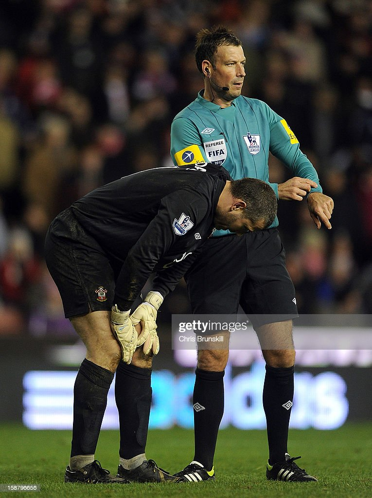 Referee Mark Clattenburg stops his watch as Kelvin Davis of Southampton recovers from injury during the Barclays Premier League match between Stoke City and Southampton at Britannia Stadium on December 29, 2012 in Stoke on Trent, England.