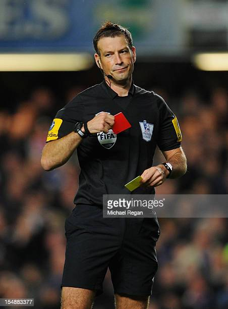 Referee Mark Clattenburg takes out his red and yellow cards when sending off Fernando Torres of Chelsea during the Barclays Premier League match...