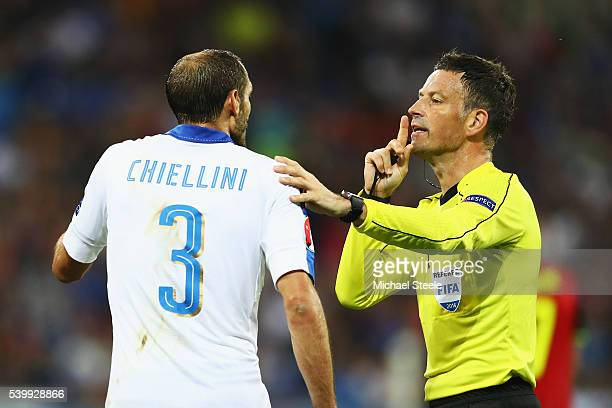Referee Mark Clattenburg talks to Giorgio Chiellini of Italy during the UEFA EURO 2016 Group E match between Belgium and Italy at Stade des Lumieres...