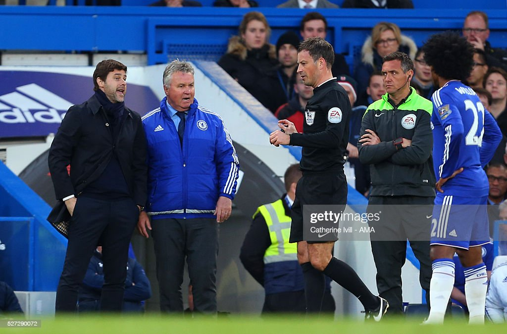 Referee Mark Clattenburg talks to Mauricio Pochettino manager of Tottenham Hotspur and Guus Hiddink interim manager of Chelsea during the Barclays Premier League match between Chelsea and Tottenham Hotspur at Stamford Bridge on May 2, 2016 in London, England.