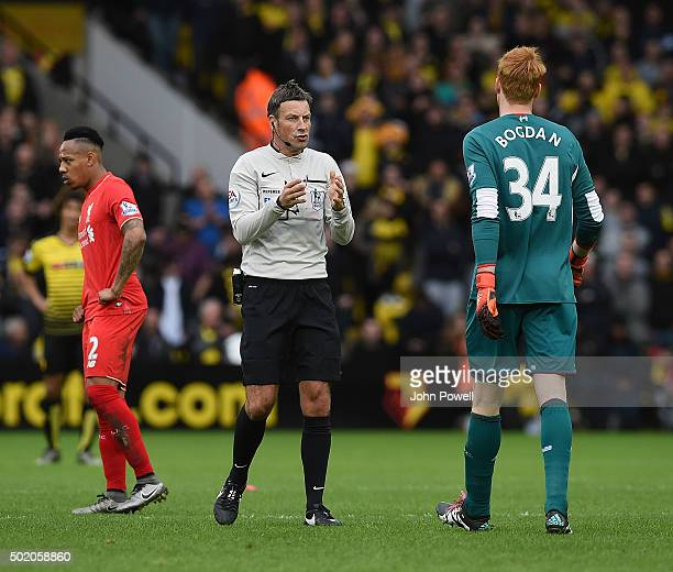 Referee Mark Clattenburg talks with Adam Bogdan of Liverpool during the Barclays Premier League match between Watford and Liverpool at Vicarage Road...