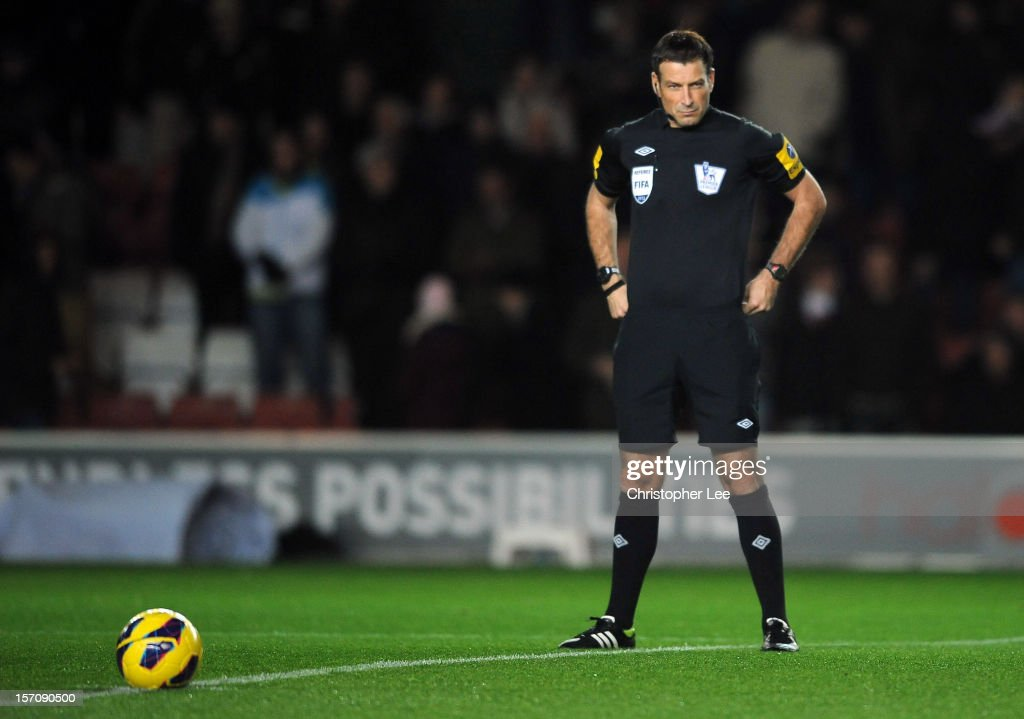 Referee <a gi-track='captionPersonalityLinkClicked' href=/galleries/search?phrase=Mark+Clattenburg&family=editorial&specificpeople=2108870 ng-click='$event.stopPropagation()'>Mark Clattenburg</a> waits to meet the two captains during the Barclays Premier League match between Southampton and Norwich City at St Mary's Stadium on November 28, 2012 in Southampton, England.