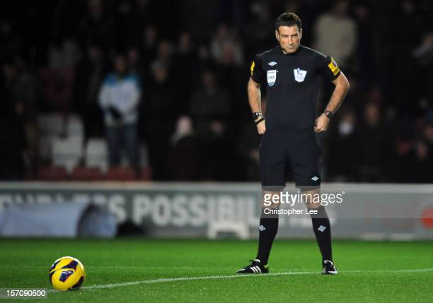 Referee Mark Clattenburg waits to meet the two captains during the Barclays Premier League match between Southampton and Norwich City at St Mary's...