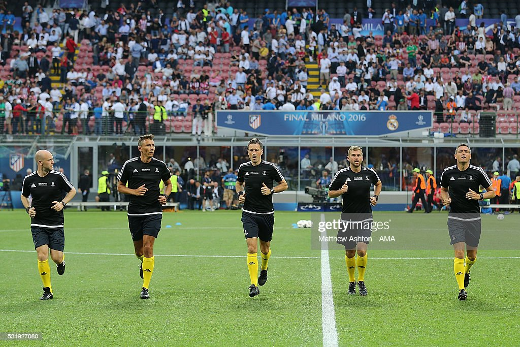 Referee Mark Clattenburg warms up with his Assistants Jake Collin and Simon Beck prior to the UEFA Champions League final match between Real Madrid and Club Atletico de Madrid at Stadio Giuseppe Meazza on May 28, 2016 in Milan, Italy.