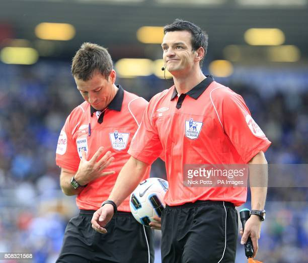 Referee Mark Clattenburg with his assistant Andy Madley