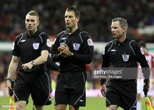 Referee Mark Clattenburg with his assistants