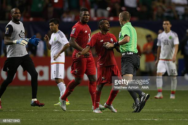 Referee Mark Geiger is confronted by Alberto Quintero of Panama at the end of the 2015 CONCACAF Gold Cup Semi Final between Panama and Mexico at...