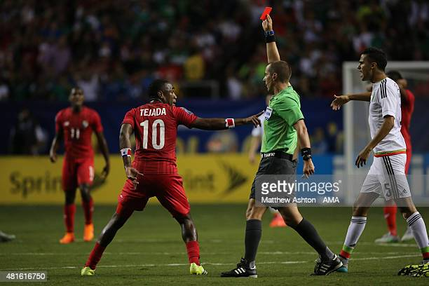 Referee Mark Geiger shows Luis Tejada of Panama a red card following a challenge on Francisco Javier Rodriguez of Mexico during 2015 CONCACAF Gold...