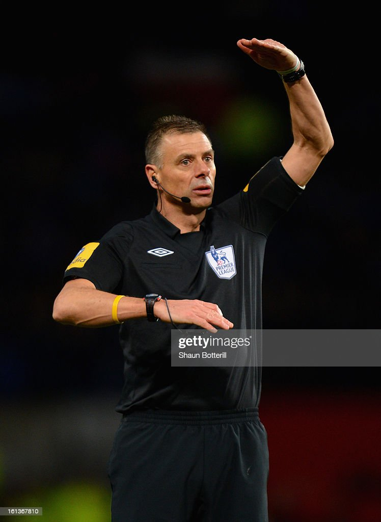 Referee Mark Halsey gestures during the Barclays Premier League match between Manchester United and Everton at Old Trafford on February 10, 2013 in Manchester, England.