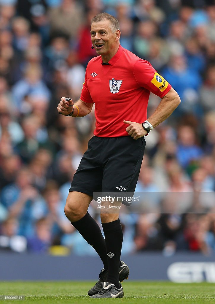 Referee <a gi-track='captionPersonalityLinkClicked' href=/galleries/search?phrase=Mark+Halsey&family=editorial&specificpeople=224397 ng-click='$event.stopPropagation()'>Mark Halsey</a> in action during his last match before retiring during the Barclays Premier League match between Manchester City and Norwich City at Etihad Stadium on May 19, 2013 in Manchester, England.