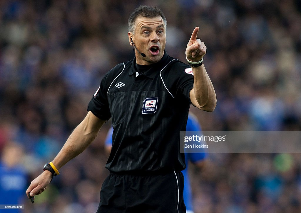 Referee <a gi-track='captionPersonalityLinkClicked' href=/galleries/search?phrase=Mark+Halsey&family=editorial&specificpeople=224397 ng-click='$event.stopPropagation()'>Mark Halsey</a> in action during the npower Championship match between Portsmouth and Southampton at Fratton Park on December 18, 2011 in Portsmouth, England.
