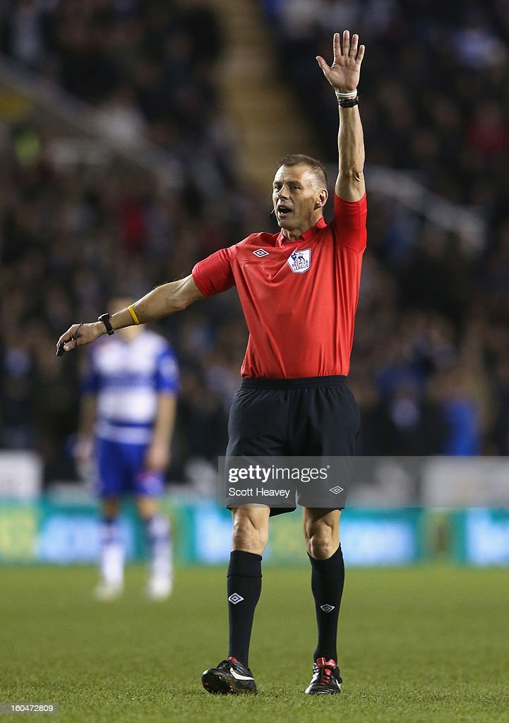 Referee Mark Halsey signals during the Barclays Premier League match between Reading and Chelsea at Madejski Stadium on January 30, 2013 in Reading, England.