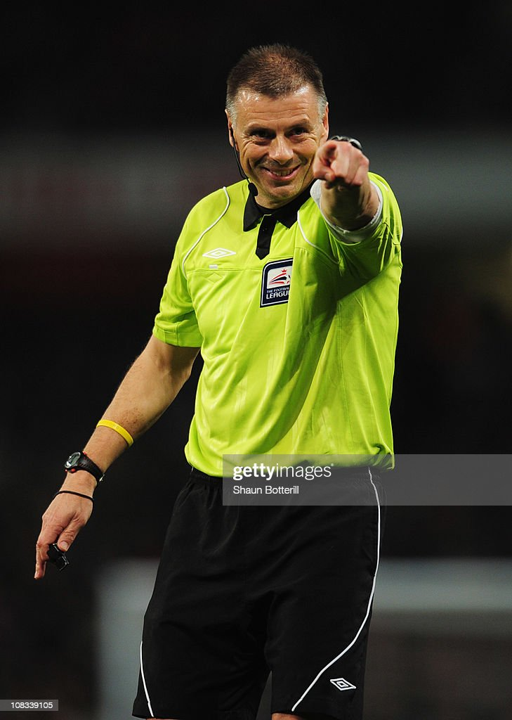 Referee <a gi-track='captionPersonalityLinkClicked' href=/galleries/search?phrase=Mark+Halsey&family=editorial&specificpeople=224397 ng-click='$event.stopPropagation()'>Mark Halsey</a> signals during the Carling Cup Semi Final Second Leg match between Arsenal and Ipswich Town at Emirates Stadium on January 25, 2011 in London, England.