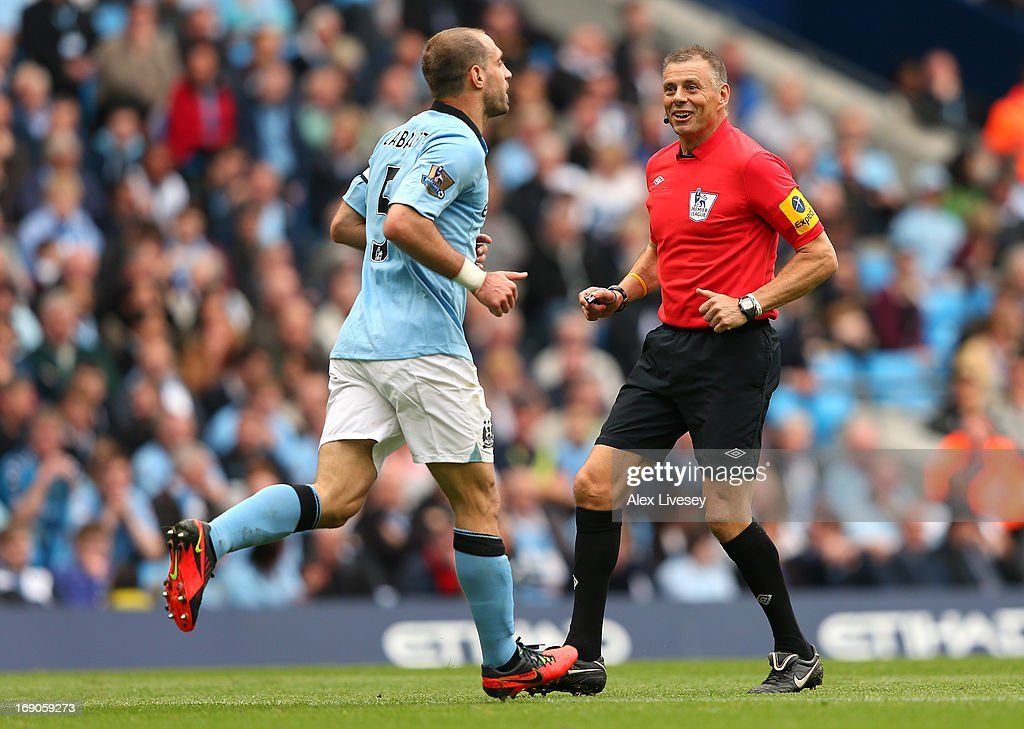 Referee <a gi-track='captionPersonalityLinkClicked' href=/galleries/search?phrase=Mark+Halsey&family=editorial&specificpeople=224397 ng-click='$event.stopPropagation()'>Mark Halsey</a> talks with Pablo Zabaleta of Manchester City during his last match before retiring during the Barclays Premier League match between Manchester City and Norwich City at Etihad Stadium on May 19, 2013 in Manchester, England.