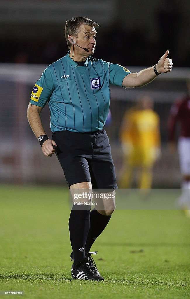 Referee Mark Haywood in action during the Johnstone's Paint Trophy Quarter Final match between Northampton Town and Leyton Orient at Sixfields Stadium on December 5, 2012 in Northampton, England.