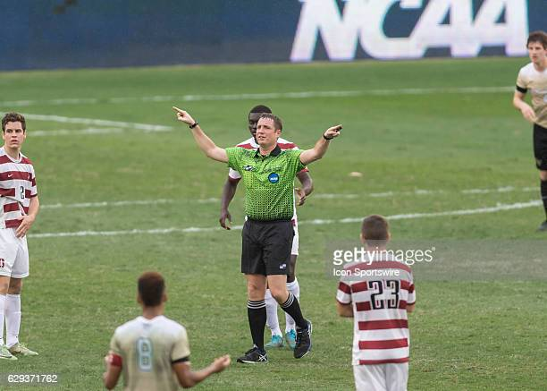 Referee Mark Kadkecik signals that there will be a review on a Stanford Cardinal shot on goal during the NCAA Men's College Cup National Championship...