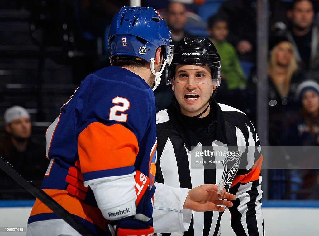 Referee Mark Lemelin #41 works his first NHL game between the New York Islanders and the Tampa Bay Lightning at the Nassau Veterans Memorial Coliseum on January 21, 2013 in Uniondale, New York.