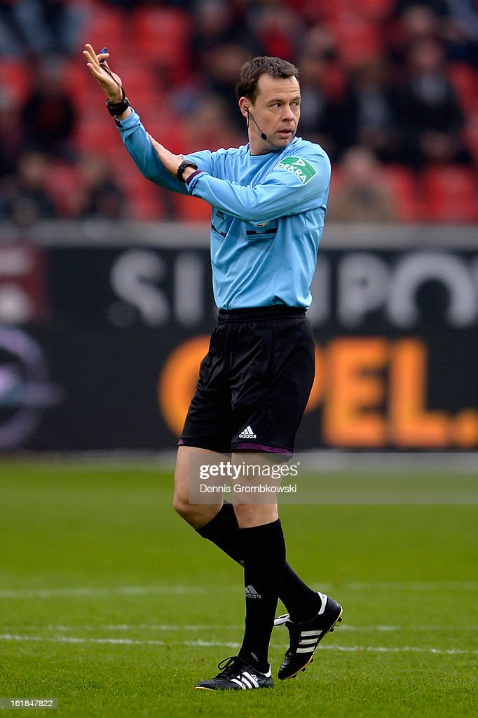 Referee Markus Schmidt reacts during the Bundesliga match between Bayer 04 Leverkusen and FC Augsburg at BayArena on February 16, 2013 in Leverkusen, Germany.