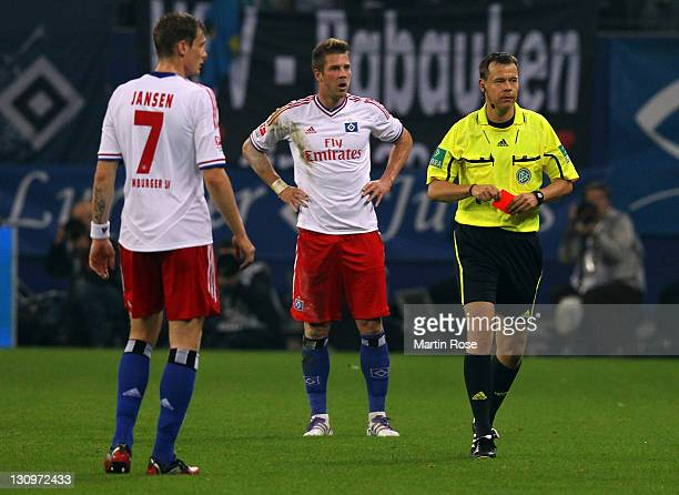 Referee Markus Schmidt shows Slobodas Rajkovic of Hamburg the red card during the Bundesliga match between Hamburger SV and 1 FC Kaiserslautern at...