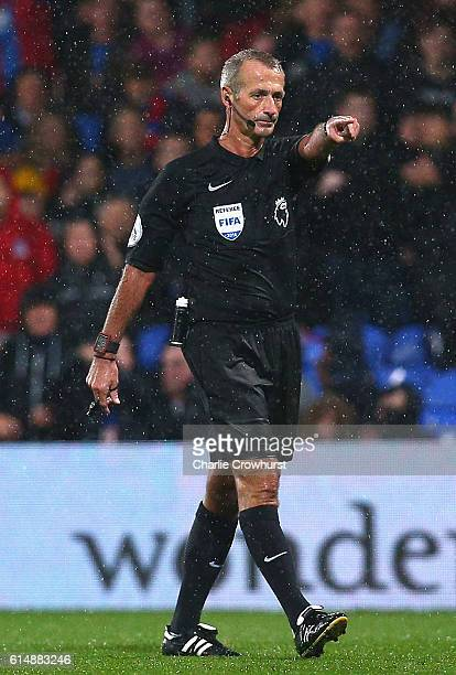 Referee Martin Atkinson awards Crystal Palace a penalty during the Premier League match between Crystal Palace and West Ham United at Selhurst Park...
