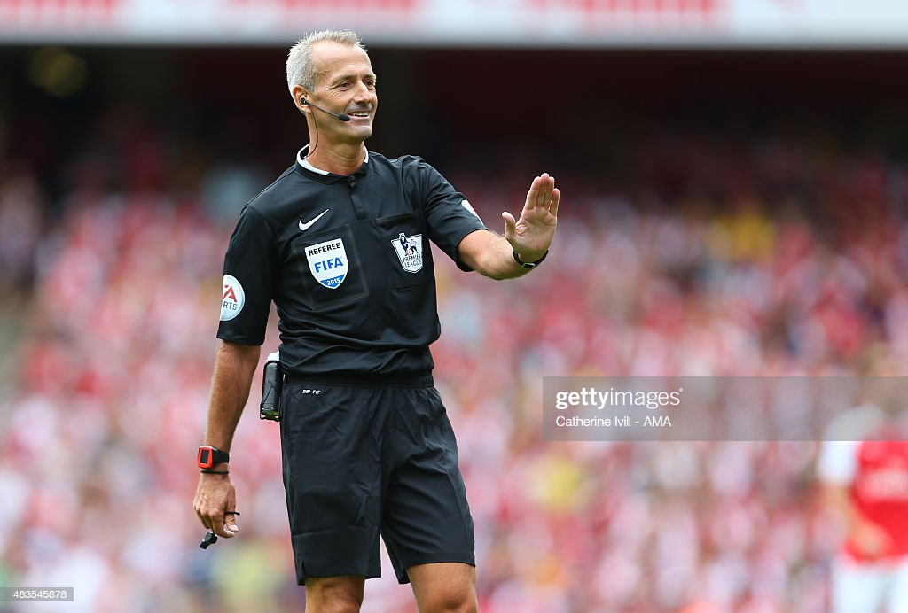 Referee <a gi-track='captionPersonalityLinkClicked' href=/galleries/search?phrase=Martin+Atkinson&family=editorial&specificpeople=703318 ng-click='$event.stopPropagation()'>Martin Atkinson</a> during the Barclays Premier League match between Arsenal and West Ham United at Emirates Stadium on August 9, 2015 in London, England.
