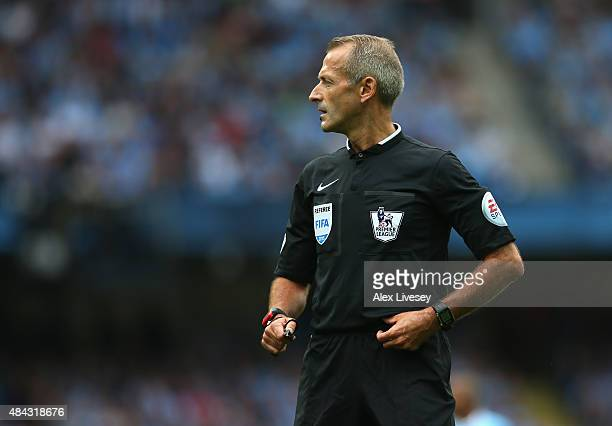 Referee Martin Atkinson during the Barclays Premier League match between Manchester City and Chelsea at Etihad Stadium on August 16 2015 in...