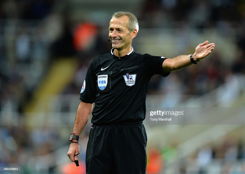 Referee <a gi-track='captionPersonalityLinkClicked' href=/galleries/search?phrase=Martin+Atkinson&family=editorial&specificpeople=703318 ng-click='$event.stopPropagation()'>Martin Atkinson</a> during the Barclays Premier League match between Newcastle United and Chelsea at St James' Park on September 26, 2015 in Newcastle upon Tyne, United Kingdom.