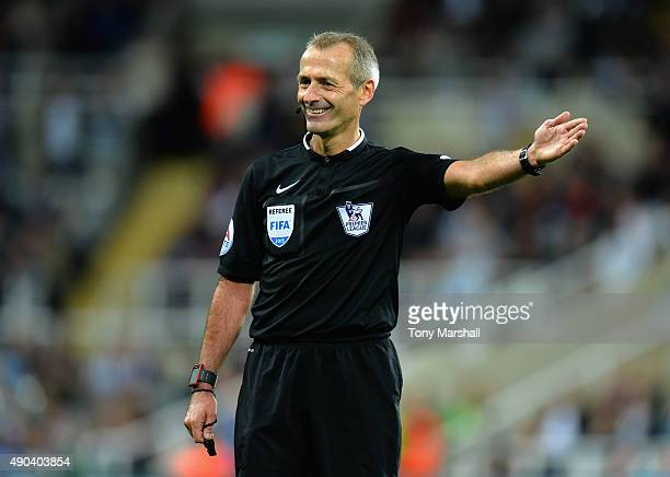 Referee Martin Atkinson during the Barclays Premier League match between Newcastle United and Chelsea at St James' Park on September 26 2015 in...