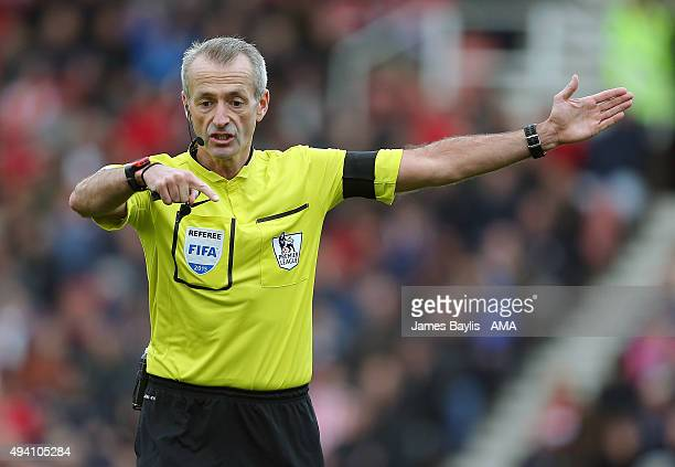 Referee Martin Atkinson during the Barclays Premier League match between Stoke City and Watford at Britannia Stadium on October 24 2015 in Stoke on...