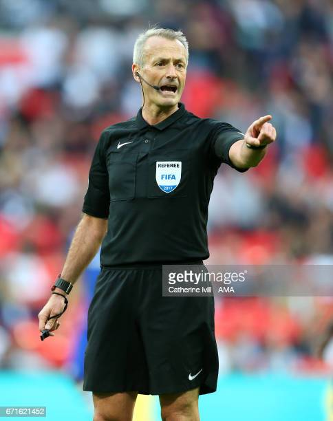 Referee Martin Atkinson during the Emirates FA Cup semifinal match between Tottenham Hotspur and Chelsea at Wembley Stadium on April 22 2017 in...