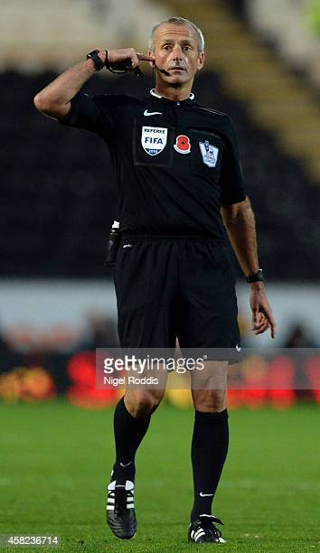 Referee Martin Atkinson during the Premier League Football match between Hull City and Southampton at KC Stadium on November 1 2014 in Hull England