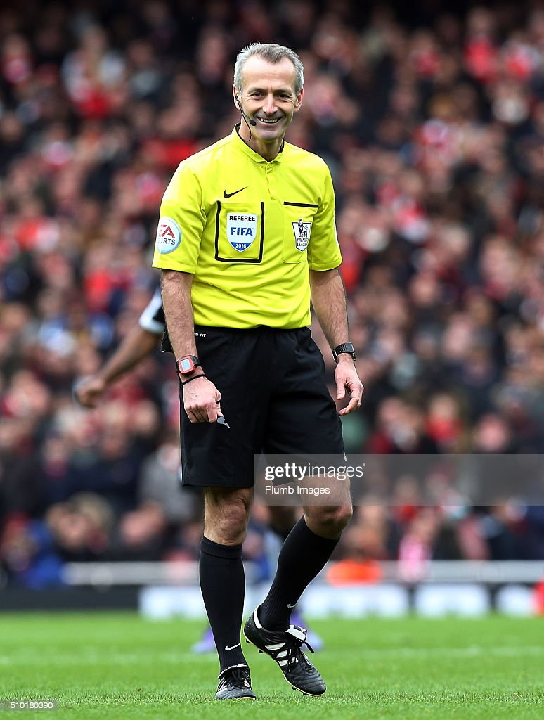 Referee Martin Atkinson during the Premier League match between Arsenal and Leicester City at Emirates Stadium on February 14, 2016 in London, United Kingdom.