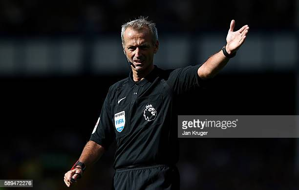 Referee Martin Atkinson during the Premier League match between Everton and Tottenham Hotspur at Goodison Park on August 13 2016 in Liverpool England