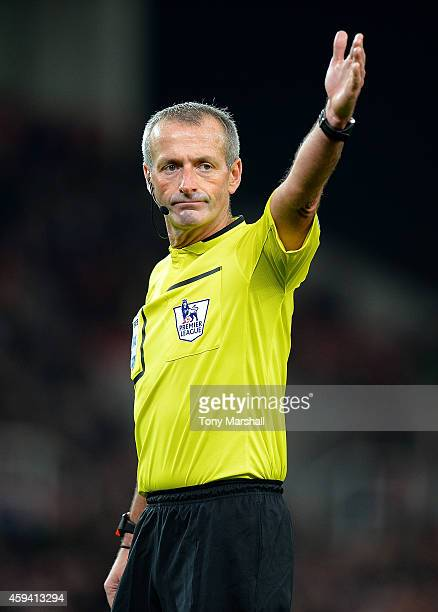 Referee Martin Atkinson gestures during the Barclays Premier League match between Stoke City and Burnley at the Britannia Stadium on November 22 2014...